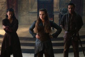 Australianactors Shalom Brune-Franklin (left), Katherine Langford (centre) and Devon Terrell star in Cursed.