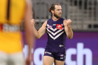 Travis Colyer celebrates a goal before his night was ended by a hamstring injury.