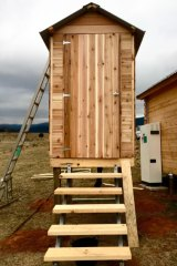 Elizabeth Farrelly's toilet is enthroned within its own long-legged cedar shed.