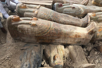 This photo provided by the Egyptian Ministry of Antiquities shows recently discovered ancient coloured coffins with inscriptions and paintings, in the southern city of Luxor, Egypt.