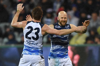 Gary Ablett celebrates a goal with Gary Rohan as Geelong hammer Carlton on Saturday afternoon.