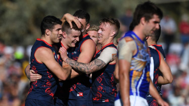 Leading light: Dees come together to congratulate Bayley Fritsch (2nd left) after a major score.