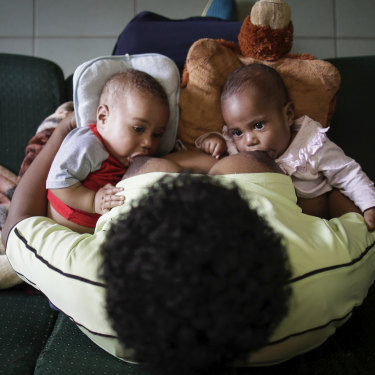 Susu Mamas midwife Sylvia Nikints breastfeeds her five-month-old babies Zita and Zion.