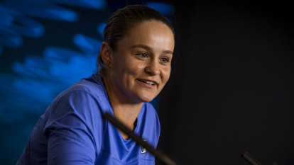 Barty goes from red clay to putting green