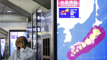 The path of Typhoon Trami is seen on a monitor at Osaka station, in Osaka, western Japan, on Sunday.