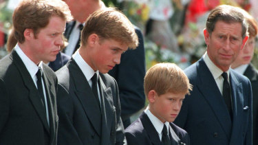 Princess Diana's sons Princes William and Harry with their father Prince Charles and uncle Earl Spencer outside Westminster Abbey on the day of their mother's funeral, September 1997.