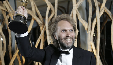 Florian Zeller with his Oscar for best adapted screenplay.