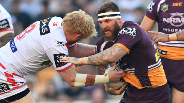 Upsetting the odds: James Graham tackles Josh McGuire of the Broncos in the Dragons' upset at Suncorp Stadium.