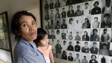 A woman visits a room with portraits of former prisoners at the notorious former Khmer Rouge prison, S-21, now the Tuol Sleng genocide museum in Phnom Penh, Cambodia