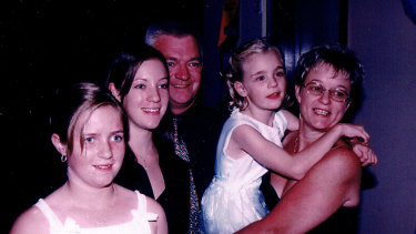 From left to right: Carlie, Chloe, Maurice, Lisa and Rhonda Higgins at a family wedding in 2003.