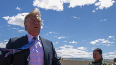 US President Donald Trump visits a section of the border wall in April 2019.