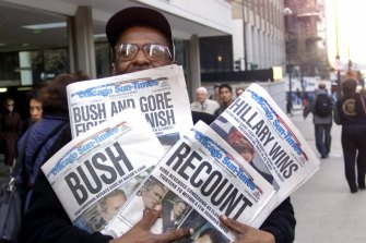 Chicagoan Willie Smith carrying copies of the Chicago Sun-Times with four different headlines.