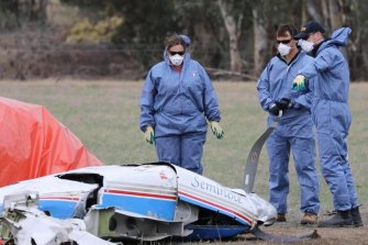 Investigators at the scene of one of the plane crashes on Wednesday.