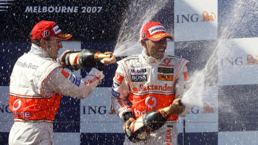 Hamilton finished third in Melbourne in 2007 and celebrates on the podium with Fernando Alonso.