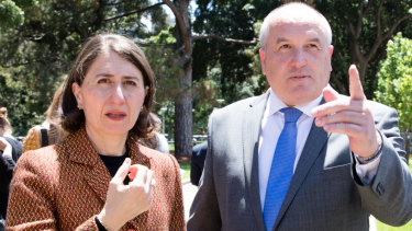 NSW Corrections Minister David Elliott, right, has apologised for raising allegations of harassment under parliamentary privilege.