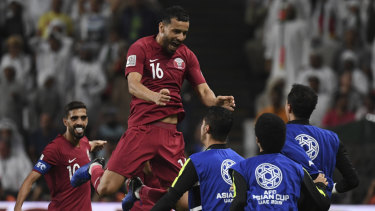 Final countdown: Boualem Khoukhi celebrates scoring the opener in Qatar's 4-0 Asian Cup semi-final rout of UAE.