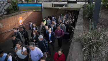 Commuters filing out of Caulfied train station on Monday morning to catch a bus.