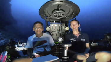 Seychelles President Danny Faure, left, inside a submersible from the vessel Ocean Zephyr, off the coast of Desroches, Seychelles.