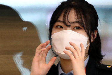 INCHEON, SOUTH KOREA - FEBRUARY 16: An airport staff member wears a mask ahead of director Bong Joon-ho's arrival at Incheon International Airport on February 16, 2020 in Incheon, South Korea. (Photo by Chung Sung-Jun/Getty Images)