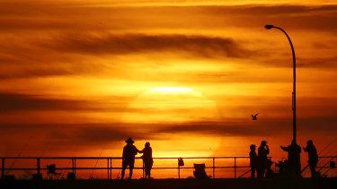 The sun rises over the Altona pier on Thursday mornng.