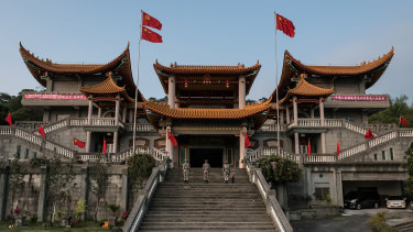 The flags of China and its Communist Party fly above a temple in Ershui Taiwan that was converted into a shrine to communism.