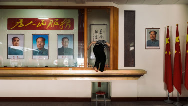 Posters of Chinese communist leader Mao Zedong and other Chinese leaders adorn the former temple.