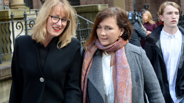 Kimberley McGurk, right, wife of murder victim Michael McGurk leaves Ron Medich's sentencing.