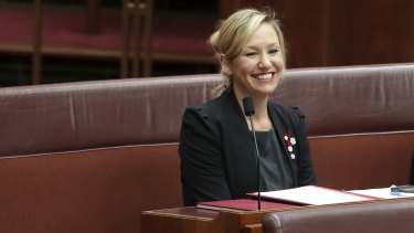 Senator Larissa Waters takes her seat in the Senate after being sworn in at Parliament House in Canberra.