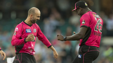 Nathan Lyon and Carlos Brathwaite celebrate in the BBL. Will England's new format prove a winner?