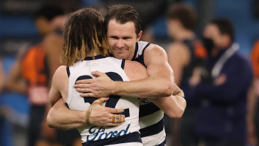 Patrick Dangerfield and Gryan Miers celebrate the Cats' win over the Giants at Optus Stadium.