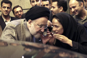 In this July 13, 2005, file photo, outgoing reformist Iranian president Mohammad Khatami with journalist Masih Alinejadin Tehran.