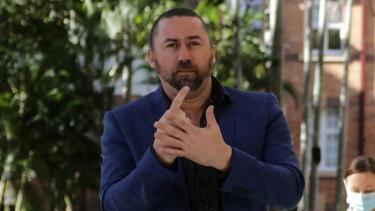 High-profile Queensland Auslan interpreter forced to quarantine