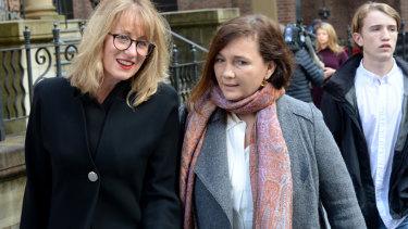 Kimberley McGurk, right, wife of murder victim Michael McGurk leaves Ron Medich's sentencing.