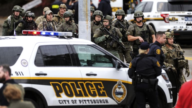 Police secure the area after a man opened fire at the Tree of Life synagogue in Pittsburgh.
