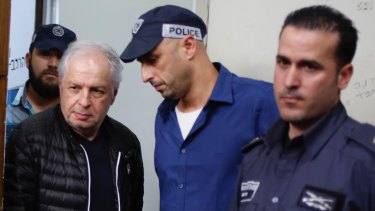 Bezeq telecom company's controlling shareholder Shaul Elovitch arrives at the magistrate court in Tel Aviv, Israel, in February, 2018.  Elovitch is suspected of involvement in a scandal in which Israeli Prime Minister Benjamin Netanyahu promoted regulation worth hundreds of millions of dollars for Bezeq in exchange for favourable coverage in the Bezeq owned Walla News site.