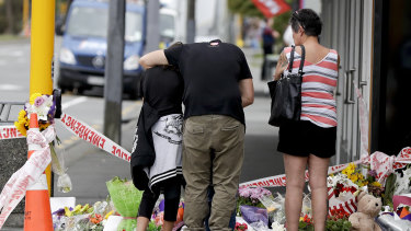 Mourners pay their respects at a makeshift memorial near the Masjid Al Noor mosque in Christchurch.