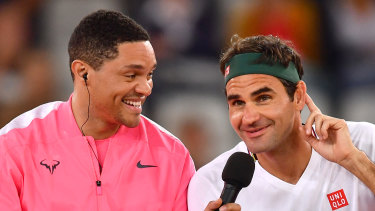 The Daily Show host Trevor Noah 'interviews' Federer courtside.