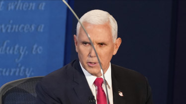 Vice President Mike Pence looks through the plexiglass barrier while he answers a question during the vice-presidential debate.