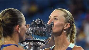 Timea Babos of Hungary and Kristina Mladenovic of France pose after winning the women's doubles championship at this year's Australian Open in January.