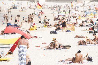Beachgoers are seen at Bondi Beach on Saturday morning despite the threat of novel coronavirus (COVID-19) in Sydney.