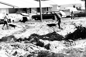 esidents of Moses Lake, Wash., shovel large deposits of volcanic ash that were dumped on the city from the Mount St. Helens eruption, in this May 24, 1980, file photo.