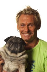 Damien Lovelock with one of his pug dogs.