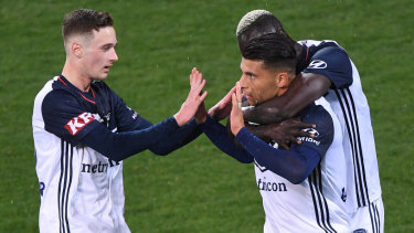 Star signing: Socceroo Andrew Nabbout (centre) celebrates a goal for Melbourne Victory.