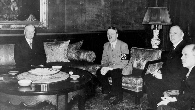 Herbert Hoover, left, meets Adolf Hitler in Berlin in 1938.