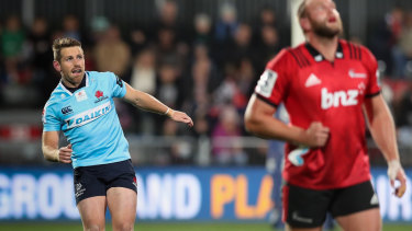 Body language: Bernard Foley follows the flight of a penalty kick against the Crusaders.