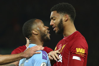 Raheem Sterling and Joe Gomez come together during Liverpool's victory over City on Sunday.