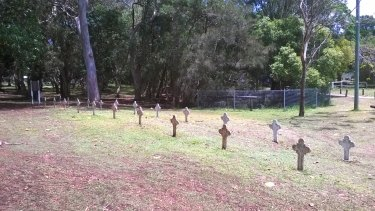 Crosses mark the approximate resting place of immigrants buried in the cemetery at Dunwich, Stradbroke Island.