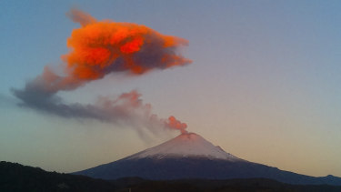 Ash and steam rise from the crater of the Popocatepetl volcano, seen from the town of San Nicolas de los Ranchos, Mexico, in 2015.
