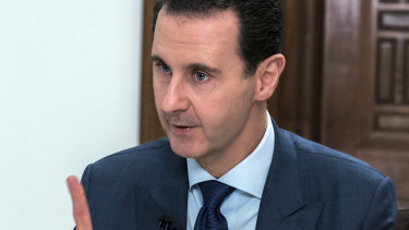 Syrian President Bashar Assad speaks during an interview with the Daily Mail, in Damascus, Syria.