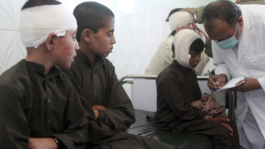 Injured boys receive treatment in a hospital after a car bomb attack in Ghazni province, central Afghanistan, on Sunday, July 7.